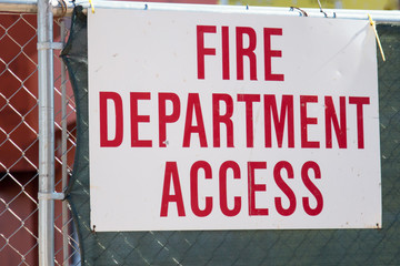 Fire Department Access sign on a fence