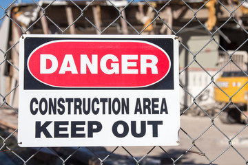 Danger Construction Area in front of a building being demolished