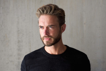 Male fashion model with beard staring
