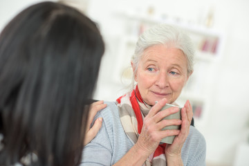 Doctor speaking to an elderly patient