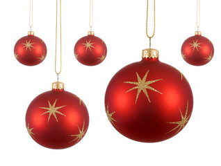 Several red Christmas balls or baubles with gold stars hanging isolated on white background