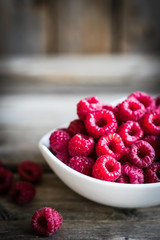 Fresh raspberries on rustic wooden background