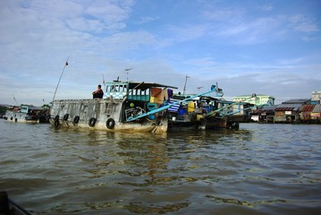 boats anchoring at floating market to sell fruits and vegetables in the south of Vietnam, Mekong Delta, South East Asia