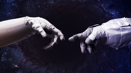 Wall Murals Nasa Michelangelo God's touch. Close up of human hands touching with fingers in space. Elements of this image furnished by NASA