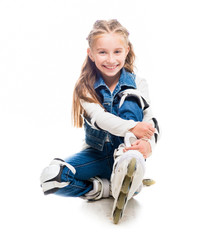 cute teenager girl on rollerskates sitting