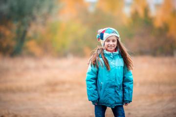 little girl playing on autumn