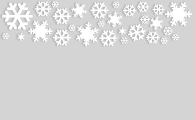 Snowflakes on gray background with copyspace.