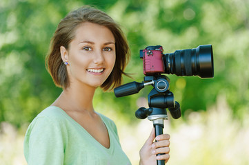 smiling beautiful young woman with camera