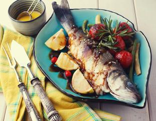 Fish baked sea bass with lemon sauce