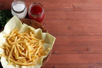 French fries in packing on a white table on a grey background