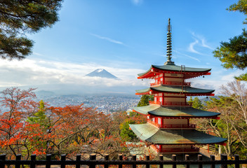 Mt. Fuji viewed from behind Chureito Pagoda with fall colors in japan.