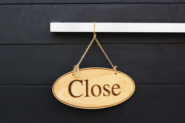 Close Sign On Wood Door