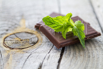 Mint leaf and chocolate, rustic wood background