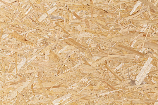 Oriented strand board, fiberboard background of texture.