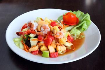 Spicy fruit salad with prawns in thai style - som tum