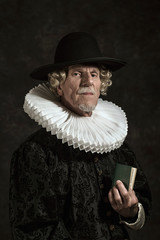 Official portrait of historical governor from the golden age. Holding book.