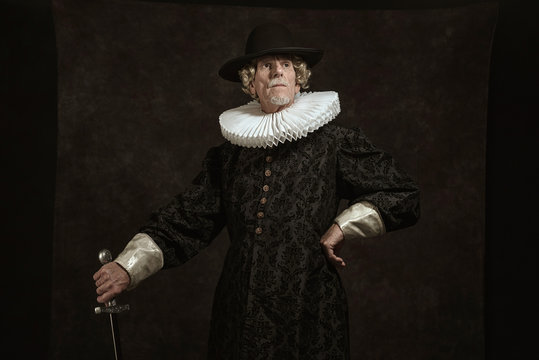 Official portrait of historical governor from the golden age. Standing with sword.