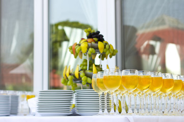 Wedding banquet outdoors. Wedding ceremony. Glasses of red and white wine. Glass of champagne
