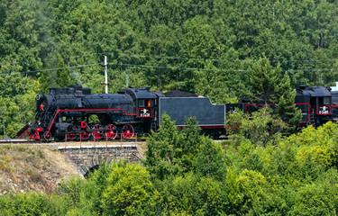 "The Soviet steam locomotive of type ""L"" On the Circum-Baikal railway. Russia. Baikal"""