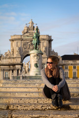 A beautiful young woman enjoys the sun in Lisbon, Portugal