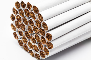 Closeup of tobacco cigarettes on white background.