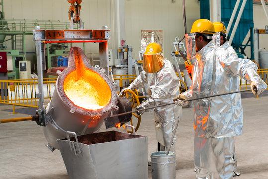 Baku, Azerbaijan-October 2015- workers melting metal Smelting in a metallurgical plant. Molten metal spill