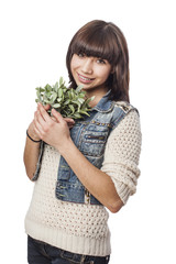 portrait of a pretty young woman holding a plant