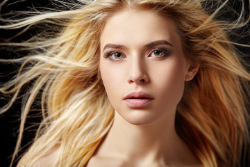 Portrait of beautiful  blonde woman with flying hair.