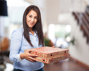 woman holding pizza boxes