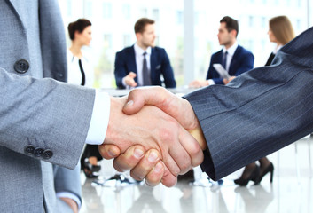 Closeup of a business handshake. Business people shaking hands