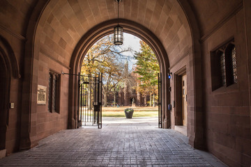 Phelps Gate at Yale University looking in towards the campus with people visible in the distance.