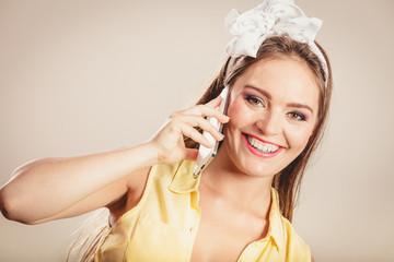 Retro pin up girl talking on mobile phone