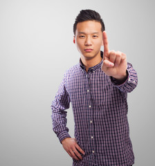 portrait of an asian man doing the one gesture