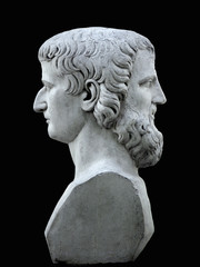 Janus sculpture on a black background. Marble bust of the mythological god of the Summer Garden of Saint Petersburg