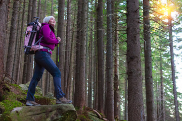 Inspired Female Hiker Staying on Stone in Forest