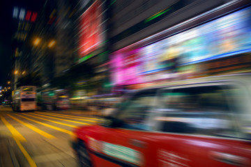 Fotomurales - Motion blurred city background in hong Kong business district
