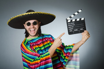 Mexican man with movie board