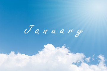 Blue sky background with january clouds word