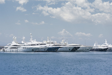 Luxury yachts in marina, docked on the pier