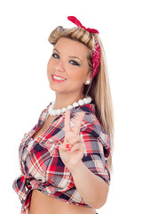 Cute girl making the sign of victory in pinup style