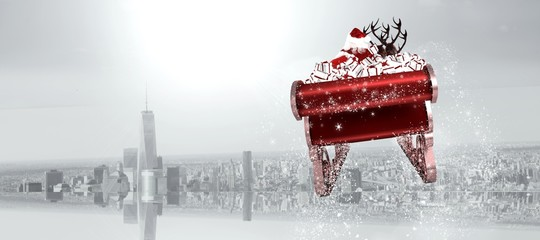 Composite image of santa flying his sleigh