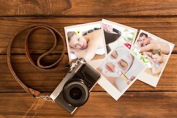 Composite image of loving young couple enjoying a back massage
