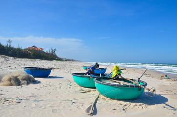 Round boats on beach