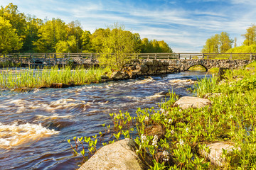 River with ancient bridge in Sweden