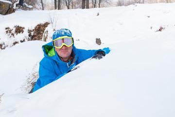 Happy  man, snowboarder resting at a ski resort