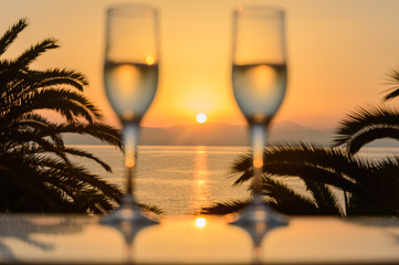 Glass of wine at sunrise at sea
