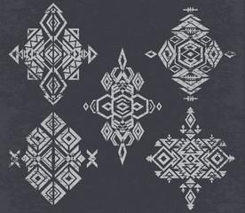 Tribal  pattern elements on grunge background.