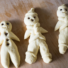 Unbaked traditional man-shaped bread prepared for St Nicholas day in german-speaking countries