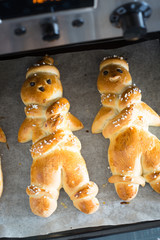 Freshly baked traditional man-shaped bread prepared for St Nicholas day in german-speaking countries