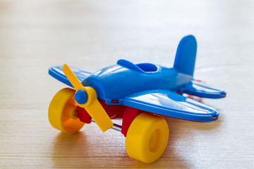 Airplane on wood background